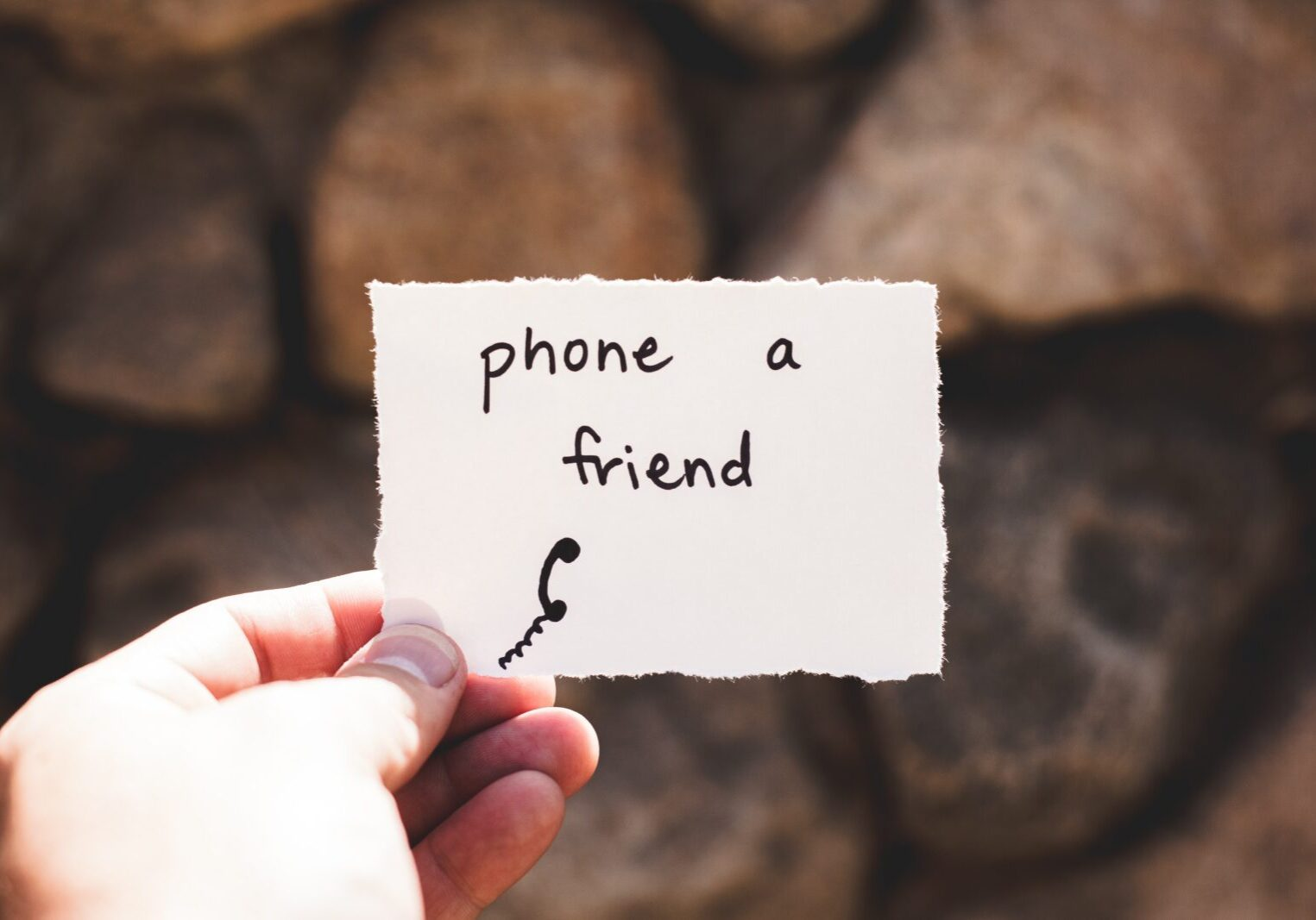 """piece of paper with """"phone a friend"""" written"""